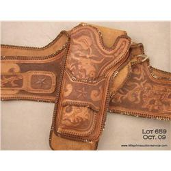 Beautifully tooled leather double holsters and  wide belt rig for a large frame revolver, such as  a