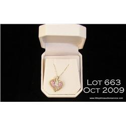 Wonderful 14 karat yellow gold ladies heart design  pendant set with pink sapphires and diamonds  we