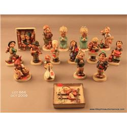 Large lot of 16 figurines by Hummel and Goebel,  blue stamped.   Est. $500-$1,000.