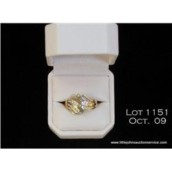 Stylish 10 karat yellow gold ladies ring channel  set with round and baguette cut diamonds weighing