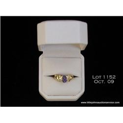 Very fine 14 karat yellow gold ladies ring set  with a center Tanzanite weighing over 1.00 carat  an