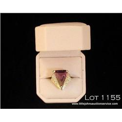 Fashionable 14 karat yellow gold ladies ring set  with a fine center custom cut amethyst weighing  a