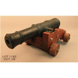 "Old desk-sized model of a cannon on wood carriage,  approx. 15"" X 8"" X 6"" with iron barrel, nicely"