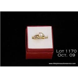 14kt yellow gold pear / diamond ring, 5 grams.   Est. $100 - $200