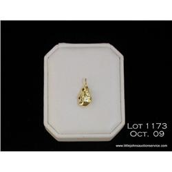 One pure gold nugget soldered with a loop wt. 7.39  grams.  Est. $250 - $500
