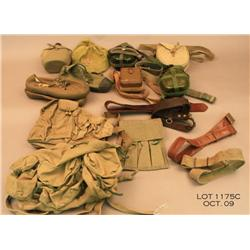 Large misc. lot of Vietnam War NVA and VC gear  equip., hats, belts and shoes.  Est. $300 - $600