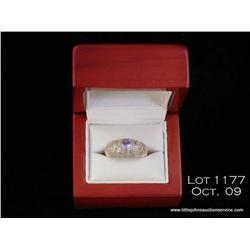 Attractive 14 karat white gold ladies designer  ring set with a center fine Tanzanite and pave set