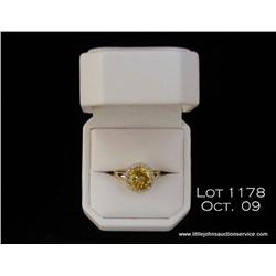 Elegant 14 karat yellow gold ladies ring set with  a custom cut center Citrine weighing approx. 4.00