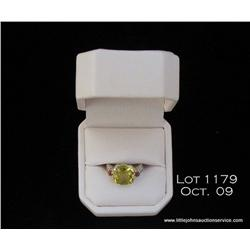 Exquisite 14 karat white gold ladies three stone  ring set with a checkerboard cut green amethyst  w