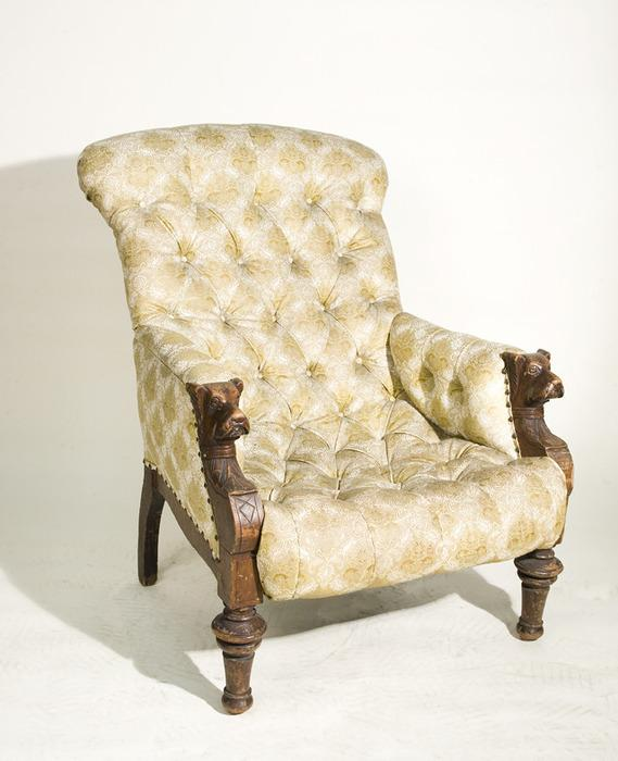 Antique Tufted Arm Chair With Carved Dog Head Arms
