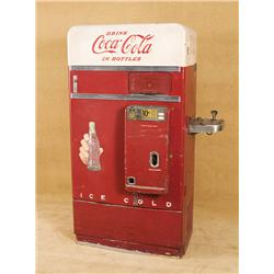 Vintage Coka Cola Bottle Vending Machine with attached water fountain