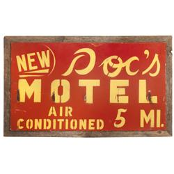 "Primitive Doc's Motel 5 miles metal sign in weathered wood frame, VG cond, 19""H x 32""W."