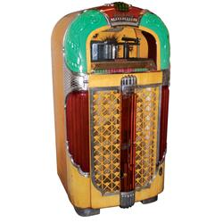 Jukebox, Rock-Ola Model 1428, two cracked plastics, complete w/replacement speaker but does not work
