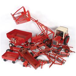 Farm toys (11), First Ed Farmall w/hay fork, McCormick 2-bottom plow, IH 2-row disc, McCormick IH 2-