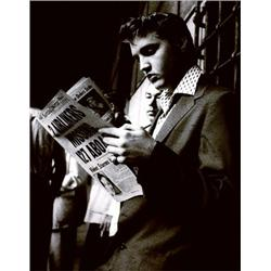 Elvis Presley Reading The Sunday Mirror Newspaper. Photograph