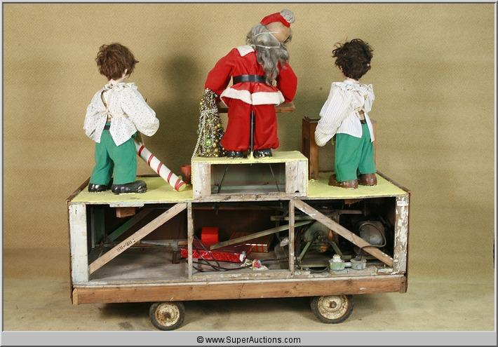 image 2 christmas animatronics set with santa and two helpers on car - Christmas Animatronics