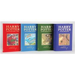 The first four Harry Potter books, Deluxe Editions, each inscribed by J. K. Rowling