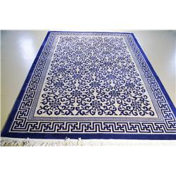 A Contemporary Blue Wool Rug with Asian Motif.