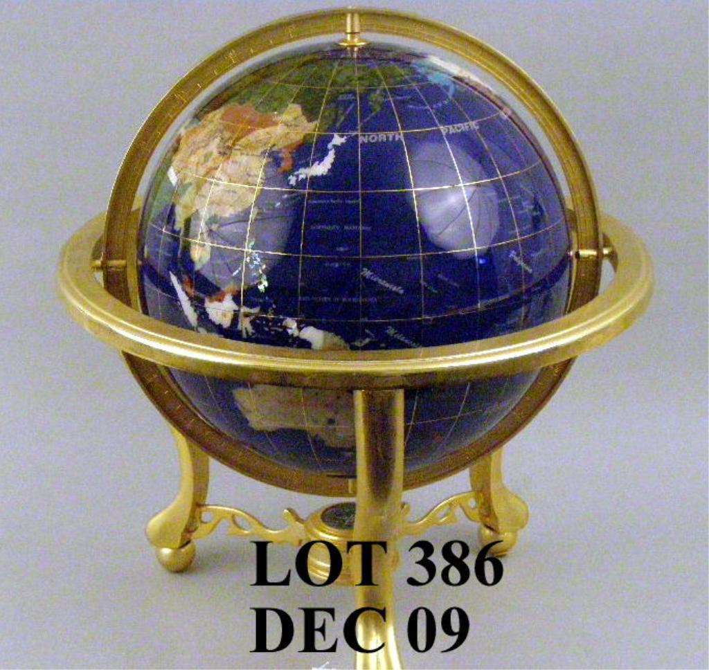 Globe made of various types of stone, pearl etc. representing ...