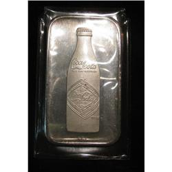 25. 1900-1975 75th Annivesary Coca-Cola One Ounce Silver .999 fine Ingot.