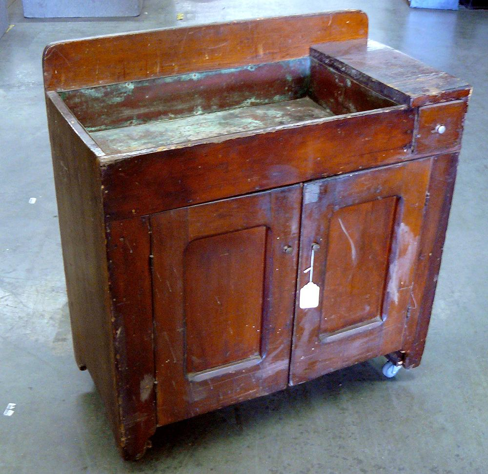 - Antique Copper Sink In Dark Wood Cabinet
