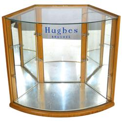 "Hughes Brushes showcase with curved glass front, needs shelves, o/wise VG cond, 16""H x 18""W."