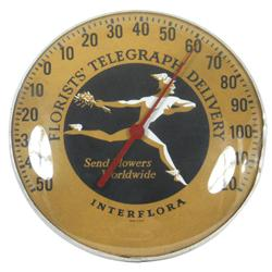 Florists' Telegraph Delivery Interflora thermometer, glass dome in metal frame, few dents in metal f