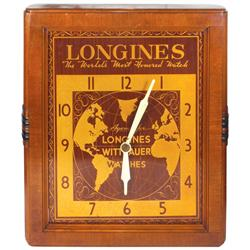 Advertising clock for Longines Wittnauer Watches, metal face in wood case, motor runs but hands don'