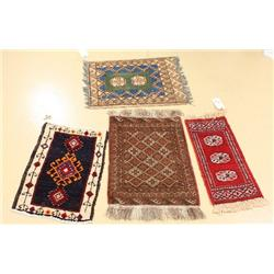 A Group of Four Persian Turkoman and Kurd Wool Rugs.