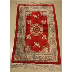 A Chinese Wool Rug with Back Cover.