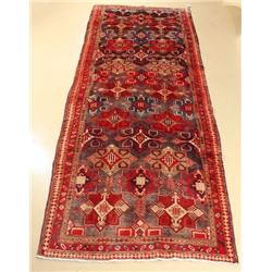 A Semi Antique Persian Heriz Wool Runner.