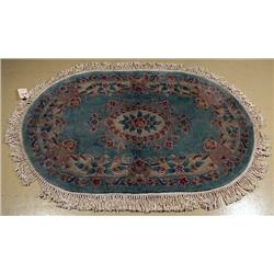 A Chinese Oval Wool Rug with Back Cover,