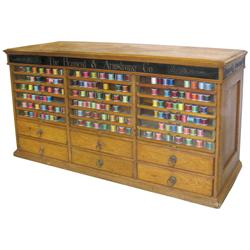 Brainerd & Armstrong Co. triple stack spool cabinet w/18 glass front doors, orig hardware & brass fi