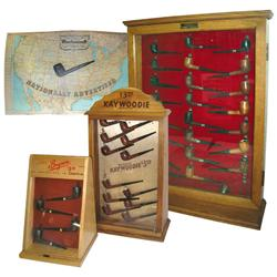 """Pipe store displays (4), Kaywoodie case w/12 pipes, 22""""H x 12""""W & Bryson case w/4 pipes, 14.5""""H x 9."""