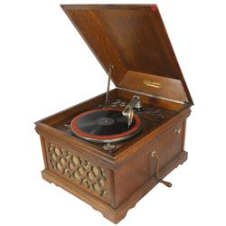 Silvertone Phonograph http://www.icollector.com/Silvertone-Phonograph-quartersawn-oak-case-w-fancy-grill-plays-78-rpm-records-VG-working-cond-15_i9442323