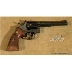 "Smith & Wesson Model 17-2 DA revolver, .22LR cal.,  6"" barrel, blue finish, combat checkered  medall"