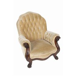 Antique Club Chair with carved lion's head arms and claw feet with button-back tan velvet upholstery