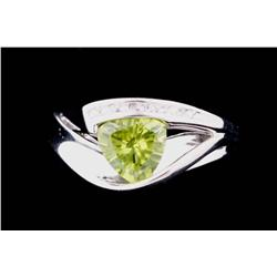 Attractive 10K White Gold Ladies Ring fine set with a center trilliant cut Peridot weighing approx 2