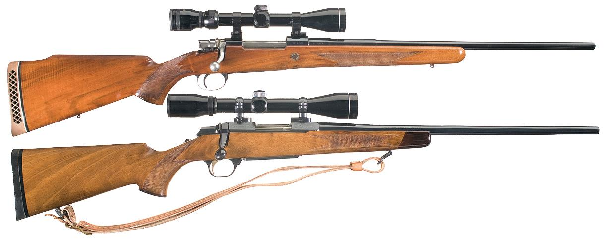 two browning bolt action rifles with scopes a belgian browning