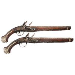 Pair of Engraved Mediterranean Flintlock Pistols with Relief Carved and Inlaid Stocks -A) Engraved O