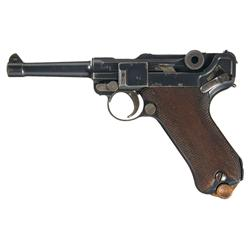 WWI German 1915 DWM Luger Pistol With Two Magazines and a Brown Leather Holster