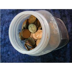 550. Dole Peach Jar 3/4 full of Old Wheat Cents. According to a list included there are some