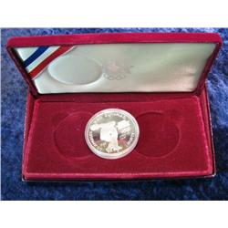 600. 1983 S Proof Olympics Silver Proof Dollar in original box.