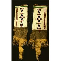 "C. 1880's Sioux leggings measuring 26"" long,"