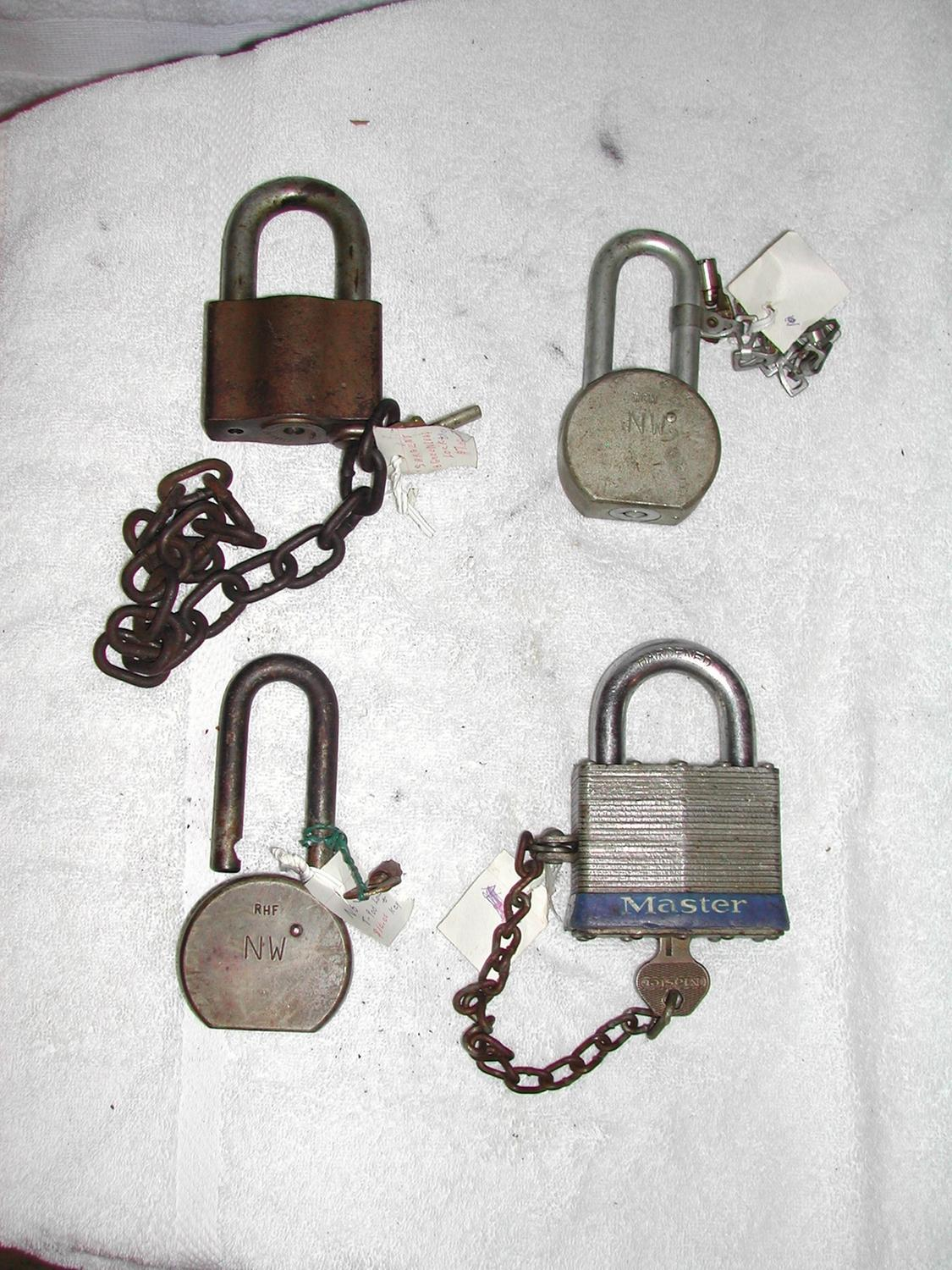 four locks with keys two n w american lock large master lock marked