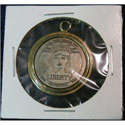 1277. 1886-1986 Liberty Centennial .999 Fine Silver Pendant containing