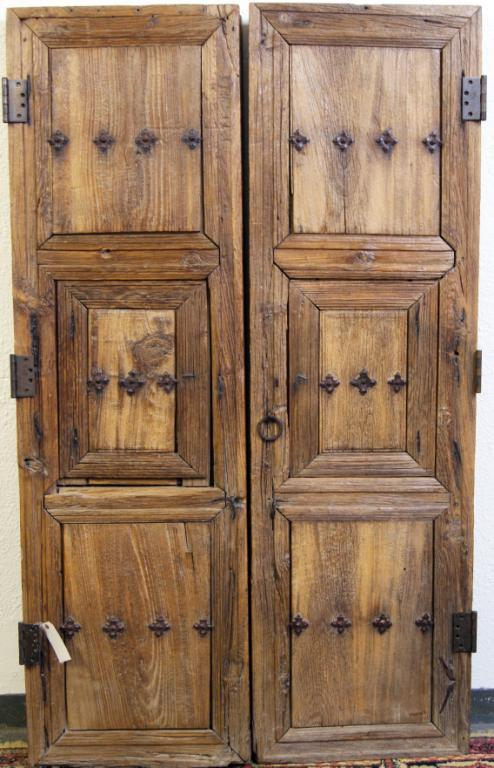 Pair Sabino Spanish Colonial tooled wood doors