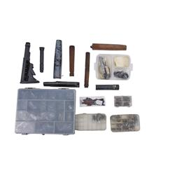 Miscellaneous Gun Parts in Plastic Cases Consisting of springs, screws, pins, barrel bands, sling sw