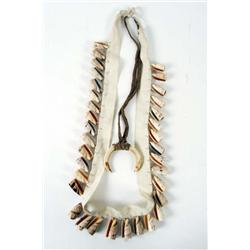 Collection of Two African Necklaces One with shells and one with boar tusks.One with shells and one