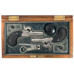 Fine Cased Pair of Le Page Marked Percussion Muff Pistols A) Folding Trigger Screw Barrel Le Page Mu